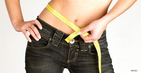 Tummy Tuck or Liposuction: How Do You Decide?